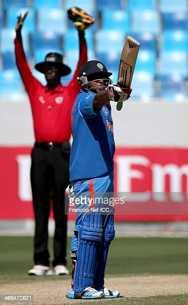 Sarfaraz Khan of India celebrates his half century during the ICC U19 Cricket World Cup 2014 match between India and Pakistan at the Dubai Sports...