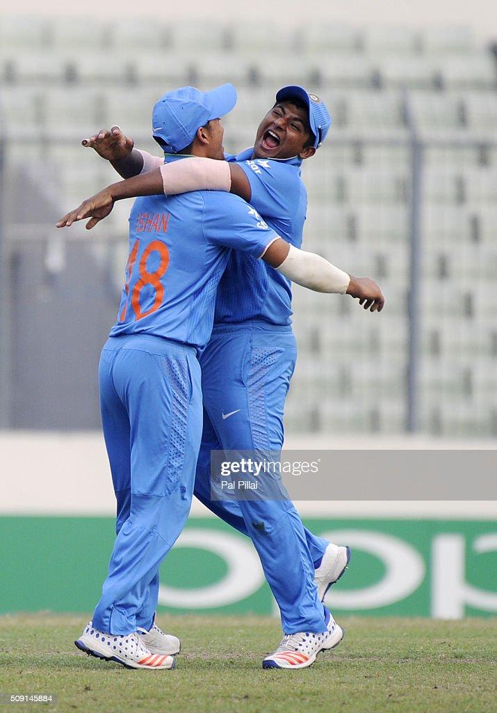 Sarfaraz Khan of India celebrates with Ishan Kishan of India as India qualifies for the ICC U19 World Cup Final after winning the Semi-Final match between India and Sri Lanka on February 9, 2016 in Dhaka, Bangladesh.