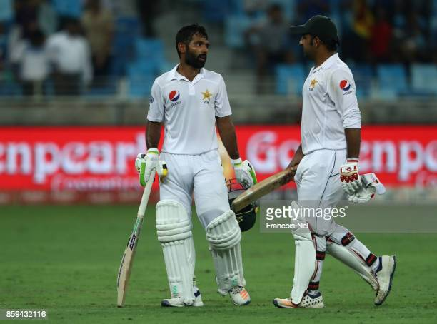 Sarfraz Ahmed and Asad Shafiq of Pakistan leave the field at the close of play during Day Four of the Second Test between Pakistan and Sri Lanka at...