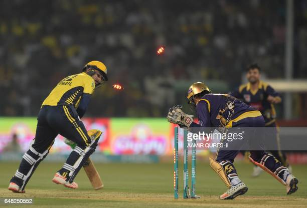 Sarfraz Ahmed captain and wicketkeeper of Quetta Gladiators stumps out Peshawar Zalmi batsman Khusdil Shah during the final cricket match of the...