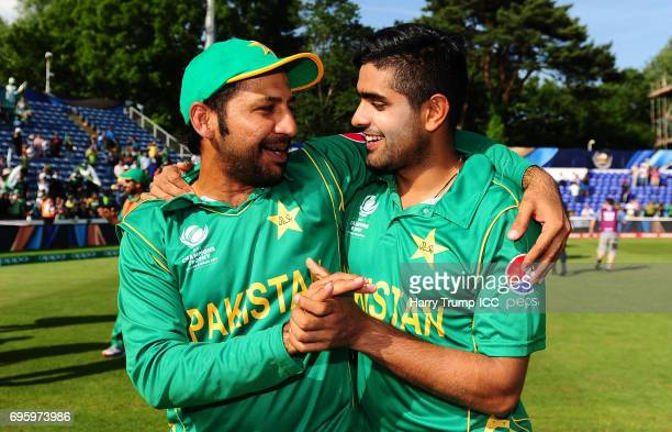 Sarfraz Ahmed Captain of Pakistan celebrates victory with Babar Azam of Pakistan during the ICC Champions Trophy Semi Final match between England and...