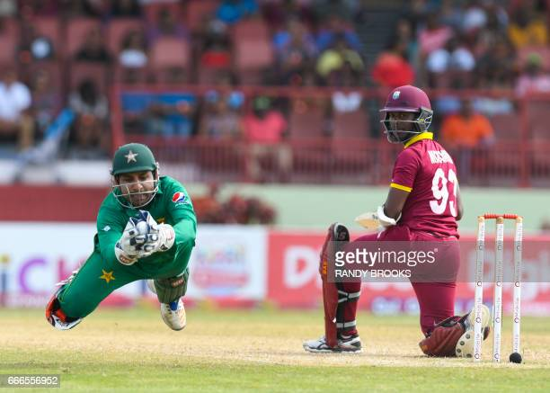 Sarfraz Ahmed of Pakistan catching Jason Mohammed of West Indies during the 2nd ODI match between West Indies and Pakistan at Guyana National Stadium...
