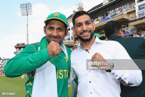 Sarfraz Ahmed of Pakistan celebrates his teams win with boxer Amir Khan after beating India during the ICC Champions Trophy Final between Pakistan...