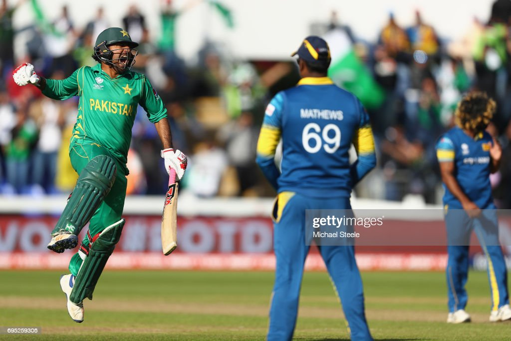 Sarfraz Ahmed of Pakistan celebrates hitting the winning runs and victory by 3 wickets as Sri Lanka captain Angelo Mathews (C) looks on during the ICC Champions Trophy match between Sri Lanka and Pakistan at the SWALEC Stadium on June 12, 2017 in Cardiff, Wales.