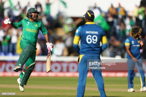 Sarfraz Ahmed of Pakistan celebrates hitting the winning runs and victory by 3 wickets as Sri Lanka captain Angelo Mathews looks on during the ICC...