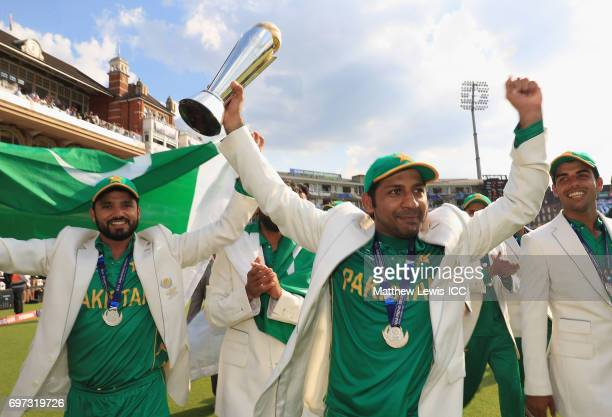 Sarfraz Ahmed of Pakistan celebrates with his team after beating India during the ICC Champions Trophy Final between Pakistan and India at The Kia...