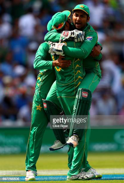 Sarfraz Ahmed of Pakistan celebrates with Imad Wasim after he takes the wicket of MS Dhoni of India during the ICC Champions trophy cricket match...
