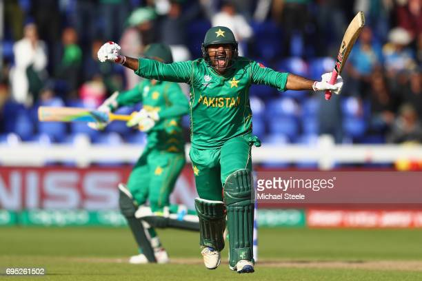 Sarfraz Ahmed of Pakistan celebrates with Mohammad Amir after hitting the winning runs and victory by 3 wickets during the ICC Champions Trophy match...