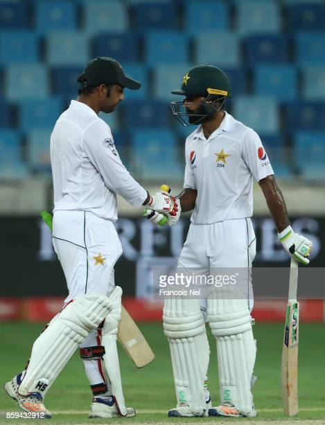 Sarfraz Ahmed of Pakistan is congratulated by Asad Shafiq of Pakistan after reaching his half century during Day Four of the Second Test between...