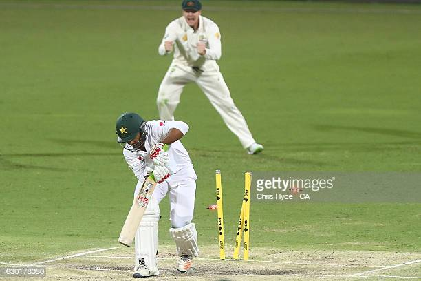 Sarfraz Ahmed of Pakistan is dismissed by Mitchell Starc of Australia during day four of the First Test match between Australia and Pakistan at The...
