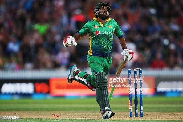Sarfraz Ahmed of Pakistan is run out by Adam Milne of the Black Caps during the International Twenty20 match between New Zealand and Pakistan at...