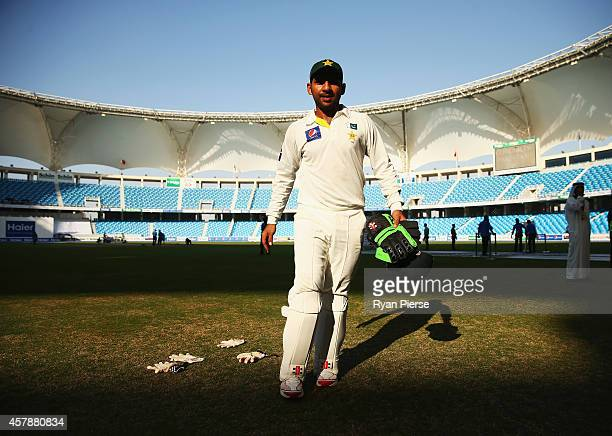 Sarfraz Ahmed of Pakistan lays out his gloves to dry after Pakistan claimed victory during Day Five of the First Test between Pakistan and Australia...
