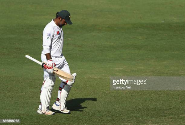 Sarfraz Ahmed of Pakistan leaves the field after being dismissed by Niroshan Dickwella of Sri Lanka during Day Five of the First Test between...