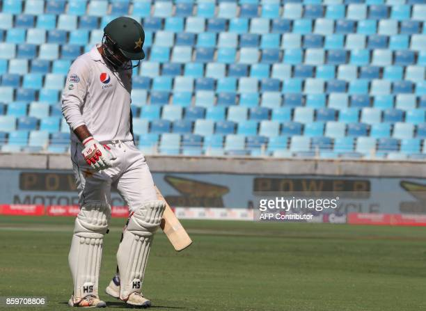 Sarfraz Ahmed of Pakistan leaves the field during the Test cricket match between Pakistan and Sri Lanka at Dubai International Cricket Ground in...