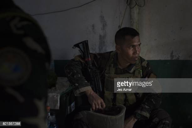 Sargeant Armando Mislani awaiting deployment as he is reinserted in the main battle area on July 21 2017 in Marawi southern Philippines Sgt Mislani...