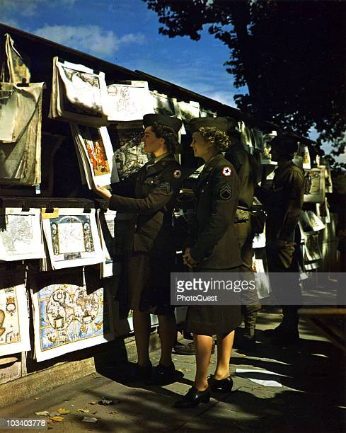 Sargeant Mary D Stewart of Gorman Texas and Corporal Ruth Quinby of Forest Hills NY contemplate purchasing a few pictures as souvenirs while...