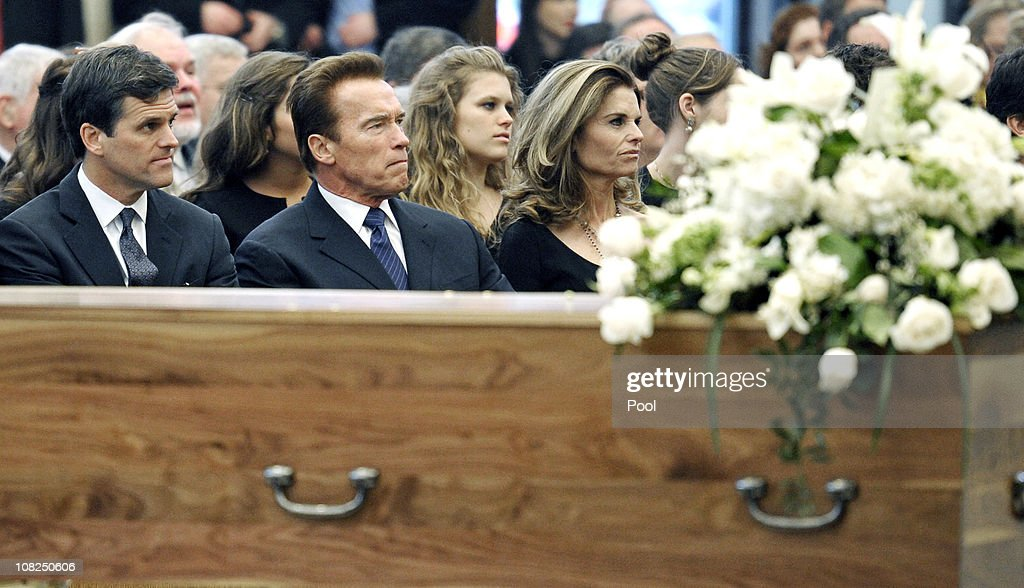 Sargent Shriver's daughter <a gi-track='captionPersonalityLinkClicked' href=/galleries/search?phrase=Maria+Shriver&family=editorial&specificpeople=179436 ng-click='$event.stopPropagation()'>Maria Shriver</a>, her husband actor and former California Gov. <a gi-track='captionPersonalityLinkClicked' href=/galleries/search?phrase=Arnold+Schwarzenegger&family=editorial&specificpeople=156406 ng-click='$event.stopPropagation()'>Arnold Schwarzenegger</a>, and her brother <a gi-track='captionPersonalityLinkClicked' href=/galleries/search?phrase=Timothy+Shriver&family=editorial&specificpeople=757215 ng-click='$event.stopPropagation()'>Timothy Shriver</a> sit near the casket during the funeral service for Sargent Shriver at Our Lady of Mercy Catholic Church January 22, 2011 in Potomac, Maryland. Robert Sargent Shriver Jr., a politician and activist who was the first leader of the Peace Corps and was involved in other social programs, died this week at the age of 95.