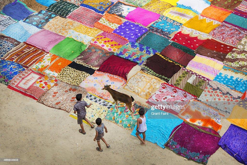 Sari drying on ground.