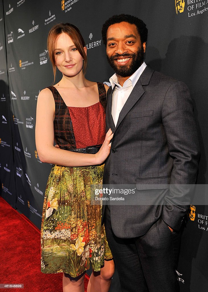 Sari Mercer (L) and actor <a gi-track='captionPersonalityLinkClicked' href=/galleries/search?phrase=Chiwetel+Ejiofor&family=editorial&specificpeople=213998 ng-click='$event.stopPropagation()'>Chiwetel Ejiofor</a> attend the BAFTA LA Awards Season Tea Party with Mulberry at the Four Seasons Hotel Los Angeles at Beverly Hills on January 11, 2014 in Beverly Hills, California.