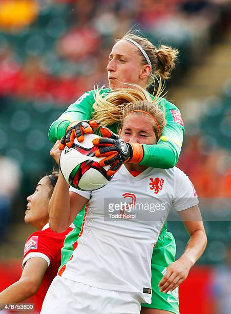 Sari Van Veenendaal catches the ball over teammate Desiree Van Lunteren of Netherlands during the FIFA Women's World Cup Canada Group A match between...