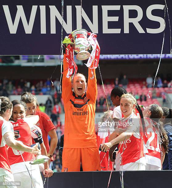 Sari van Veenendaal of Arsenal Ladies lifts the FA Cup Trophy the match between Arsenal Ladies and Chelsea Ladies at Wembley Stadium on May 14 2016...
