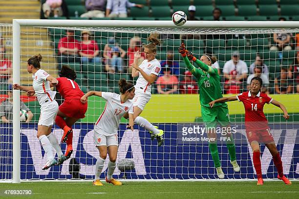 Sari Van Veenendaal of Netherlands makes a save over Zhao Rong of China PR during the FIFA Women's World Cup Canada 2015 Group A Match at...