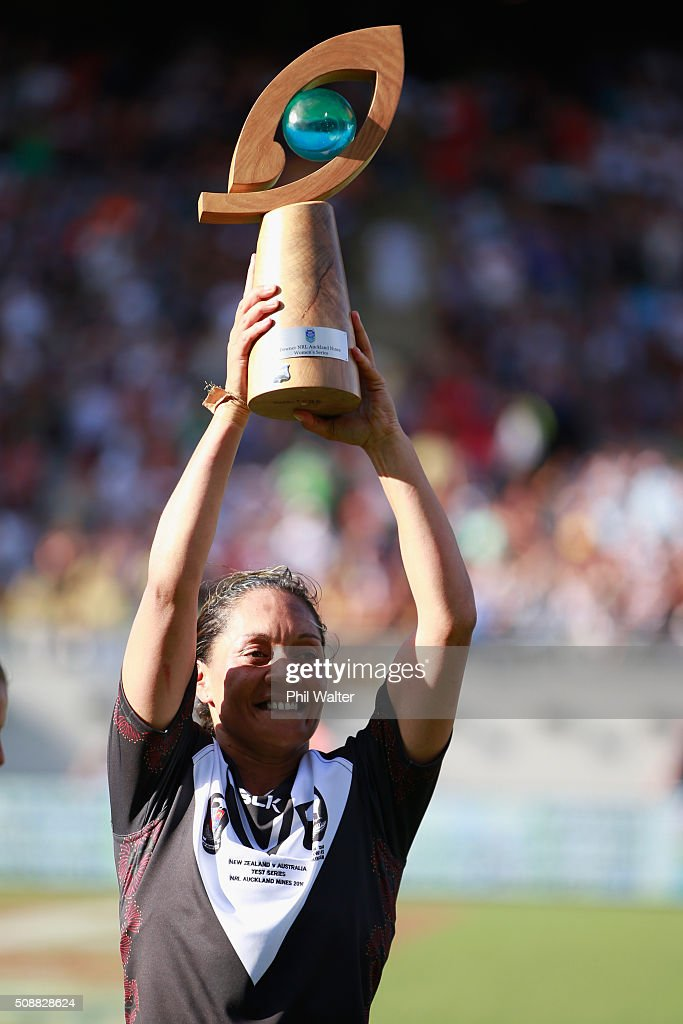 Sarina Fiso of the New Zealand Ferns holds the series trophy aloft following their win over the Australian Jillaroos during the 2016 Auckland Nines at Eden Park on February 7, 2016 in Auckland, New Zealand.
