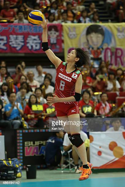 Sarina Koga of Japan serves the ball in the match between Japan and Algeria during the FIVB Women's Volleyball World Cup Japan 2015 at Nippon Gaishi...