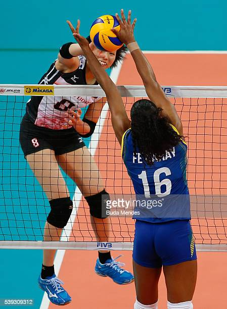 Sarina Koga of Japan spikes the ball as Fernanda Garay of Brazil defends during the match between Brazil and Japan on day 2 the FIVB Volleyball World...