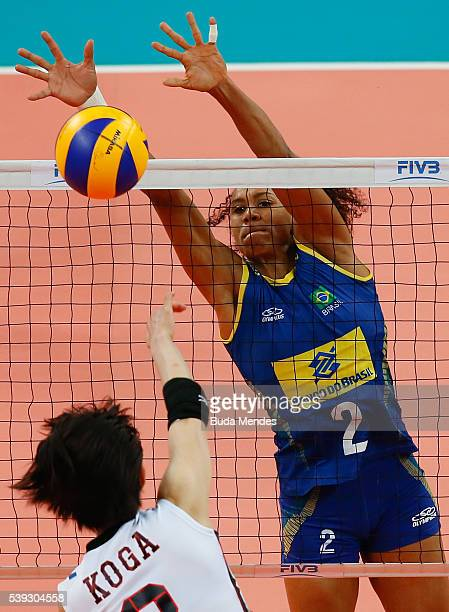 Sarina Koga of Japan spikes the ball as Juciely Cristina of Brazil defends during the match between Brazil and Japan on day 2 the FIVB Volleyball...