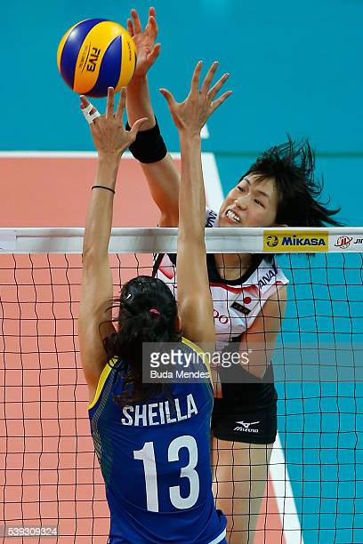 Sarina Koga of Japan spikes the ball as Sheila Castro of Brazil defends during the match between Brazil and Japan on day 2 the FIVB Volleyball World...