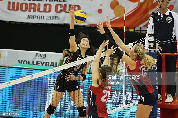Sarina Koga of Japan spikes the ball in the match between Japan and USA during the FIVB Women's Volleyball World Cup Japan 2015 at Nippon Gaishi Hall...