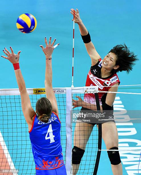 Sarina Koga spikes the ball in the first set of Japan's straightsets win over Serbia in their opening game at the World Grand Prix in Rio de Janeiro...
