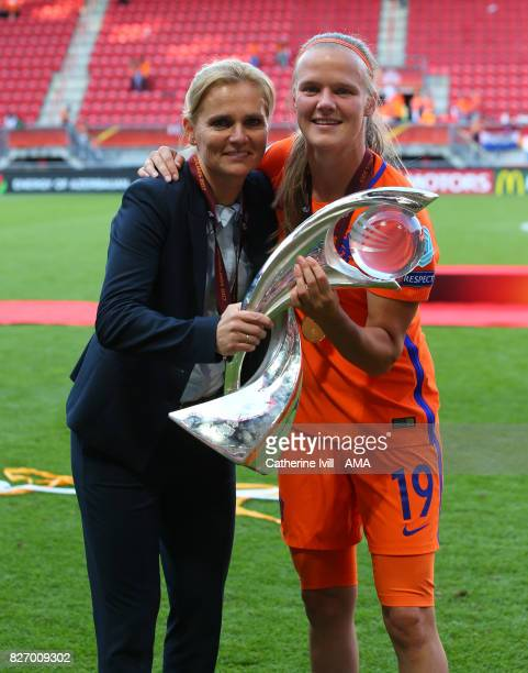 Sarina Weigman manager / head coach of Netherlands Women and Sheila Van Den Bulk of Netherlands Women celebrate with the trophy the UEFA Women's Euro...