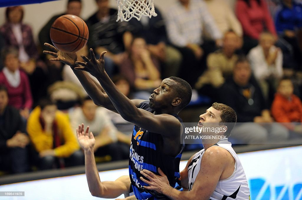 Sarra Camara (L) of French BCM Gravelines Dunkerque fights for the ball with Miklos Szabo (R) of Hungarian KK Szolnoki Olaj on January 15, 2015 during their FIBA EuroChallenge match.