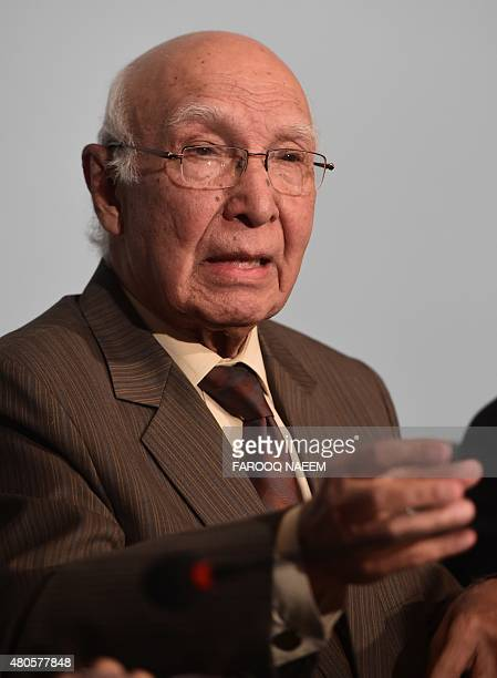 Sartaj Aziz advisor to the prime minister of Pakistan on national security and foreign affairs gestures as he briefs the media in Islamabad on July...
