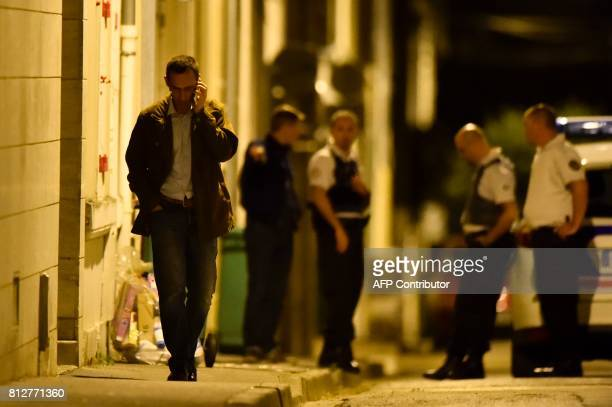Sarthe's Police Chief Emmanuel Morin phones as police officers cordon off the area next to the house of late French magistrate JeanMichel Lambert who...