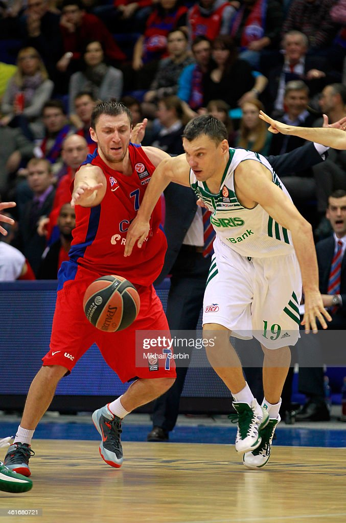 Sarunas Jasikevicius, #19 of Zalgiris Kaunas competes with Vitaly Fridzon, #7 of CSKA Moscow in action during the 2013-2014 Turkish Airlines Euroleague Top 16 Date 2 game between CSKA Moscow v Zalgiris Kaunas at USH CSKA on January 10, 2014 in Moscow, Russia.