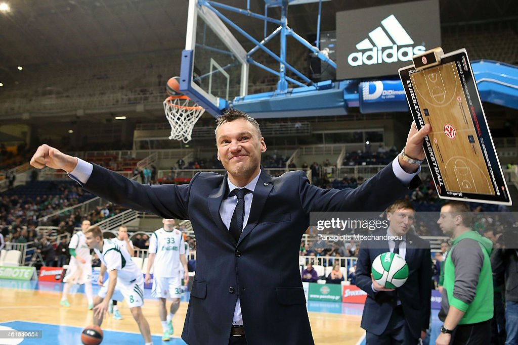 <a gi-track='captionPersonalityLinkClicked' href=/galleries/search?phrase=Sarunas+Jasikevicius&family=editorial&specificpeople=581779 ng-click='$event.stopPropagation()'>Sarunas Jasikevicius</a>, Coach of Zalgiris Kaunas, greats Panathinaikos' fans as he returns to his previous home during the Euroleague Basketball Top 16 Date 3 game between Panathinaikos Athens v Zalgiris Kaunas at Olympic Sports Center Athens on January 16, 2015 in Athens, Greece.