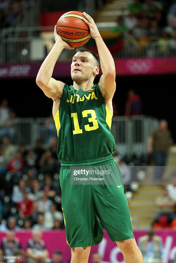 Sarunas Jasikevicius #13 of Lithuania shoots the ball against Argentina during their Men's Basketball Game on Day 2 of the London 2012 Olympic Games at the Basketball Arena on July 29, 2012 in London, England.