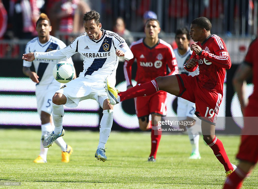 Sarvas Marcelo #8 of the Los Angeles Galaxy plays a ball against Reggie Lambe #19 of the Toronto FC in an MLS game on March 30, 2013 at BMO Field in Toronto, Ontario, Canada. The Los Angeles Galaxy and Toronto FC played to a 2-2 tie.
