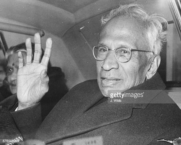 Sarvepalli Radhakrishnan President of India in the country for eye treatment waving from the back of his car after arriving at London Airport March...