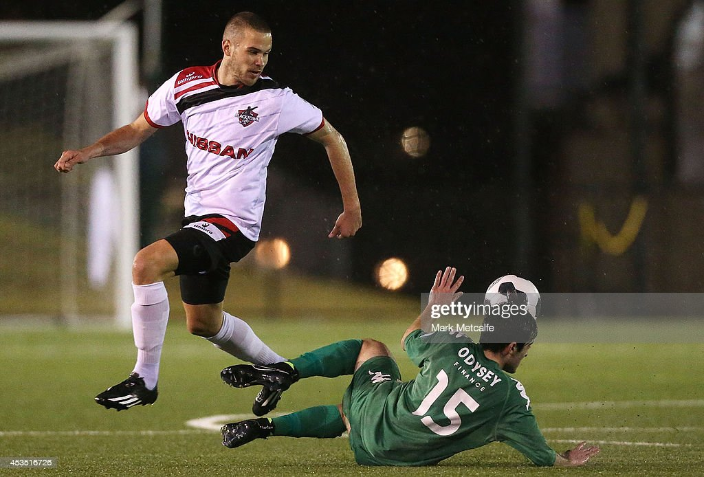 Sasa Macura of Blacktown City is tackled by Christian Cavallo of Bentleigh Greens during the FFA Cup match between Blacktown City and Bentleigh Greens at Lilys Football Centre on August 12, 2014 in Blacktown, Australia.