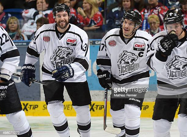 Sasa Martinovic and Patrick Reimer of the Thomas Sabo Ice Tigers Nuernberg celebrate after scoring the 23 during the game between the Eisbaeren...