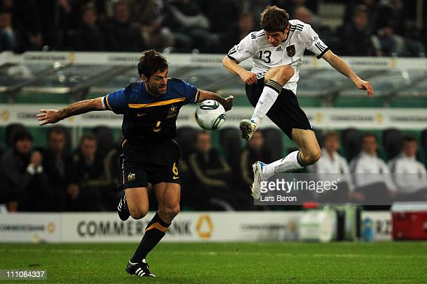 Sasa Ognenovski of Australia challenges Thomas Mueller of Germany during the international friendly match between Germany and Australia at...
