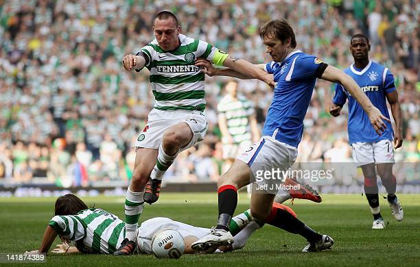 Sasa Papac of Rangers tackles Scott Brown of Celtic during the Scottish Clydesdale Bank Scottish Premier League match between Rangers and Celtic at...