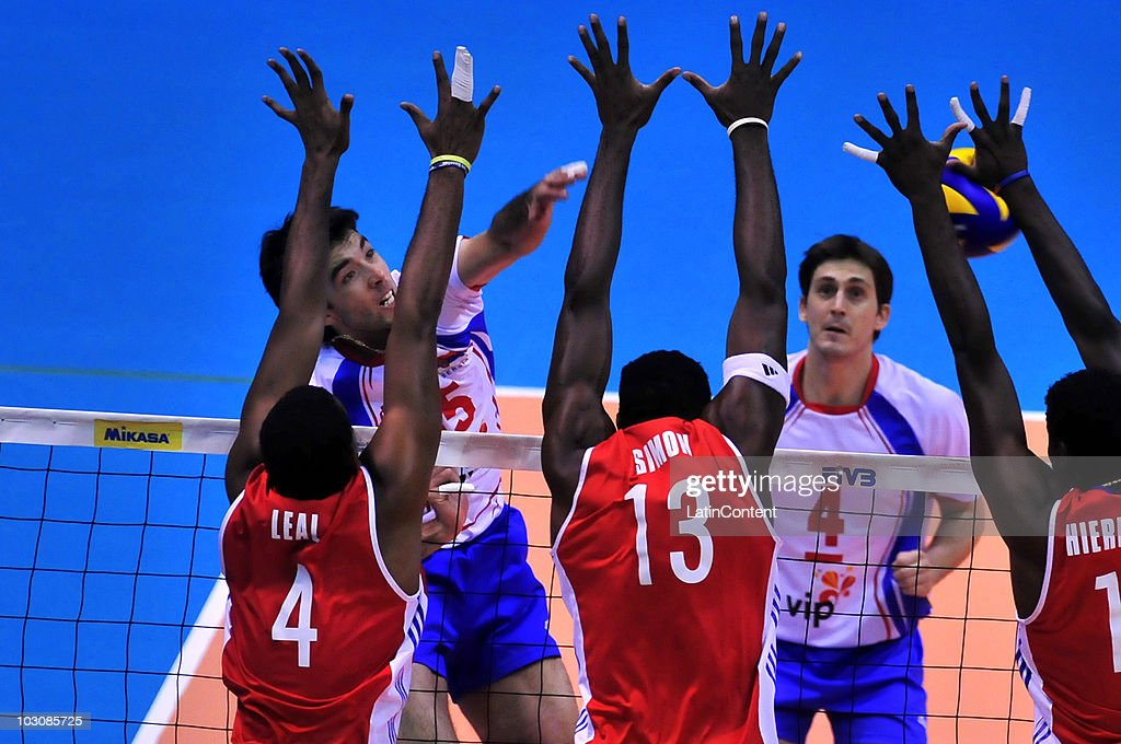Sasa Starovic of Serbia spikes against Joandry Leal Hidalgo Robertlandy Simon Aties and Raydel Hierrezuelo Aguirre of Cuba during the third place...