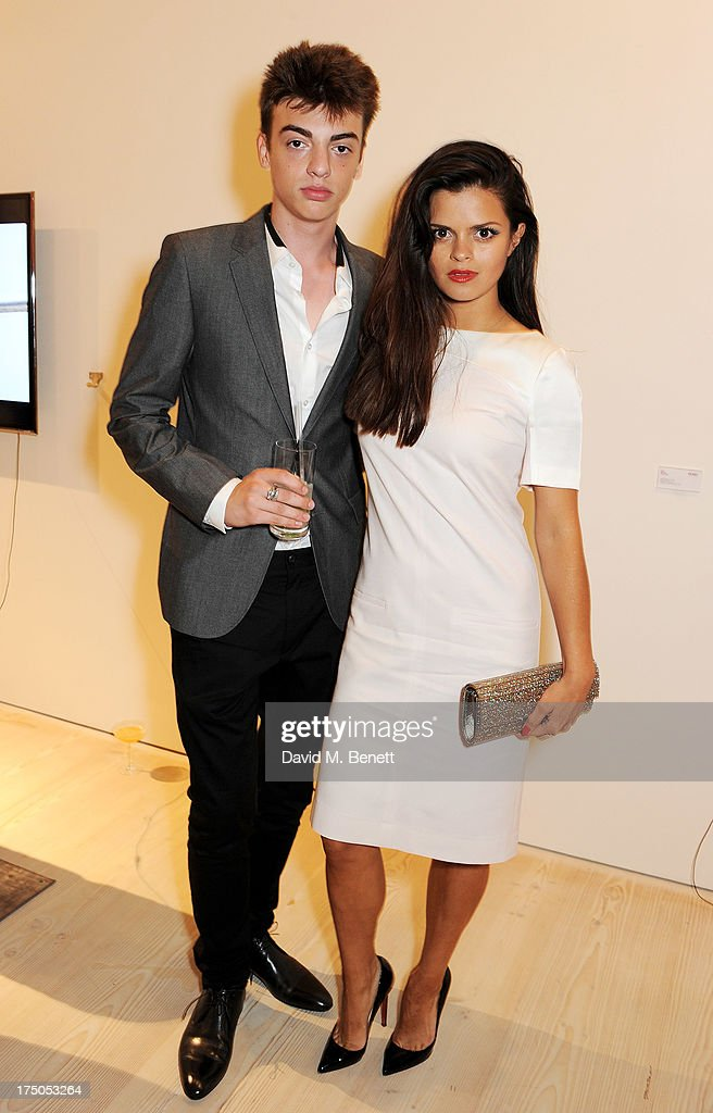 Sascha Bailey (L) and Bip Ling attend a private view of 'HUGO: Red Never Follows', celebrating 20 years of Hugo Boss, at the Saatchi Gallery on July 30, 2013 in London, England.