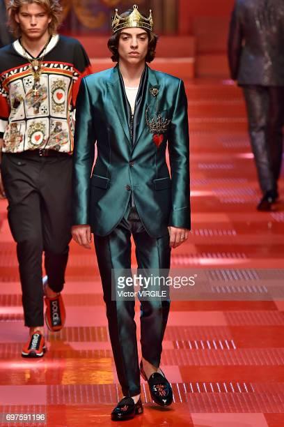 Sascha Bailey and Jordan Barrett walk the runway at the Dolce Gabbana show during Milan Men's Fashion Week Spring/Summer 2018 on June 17 2017 in...