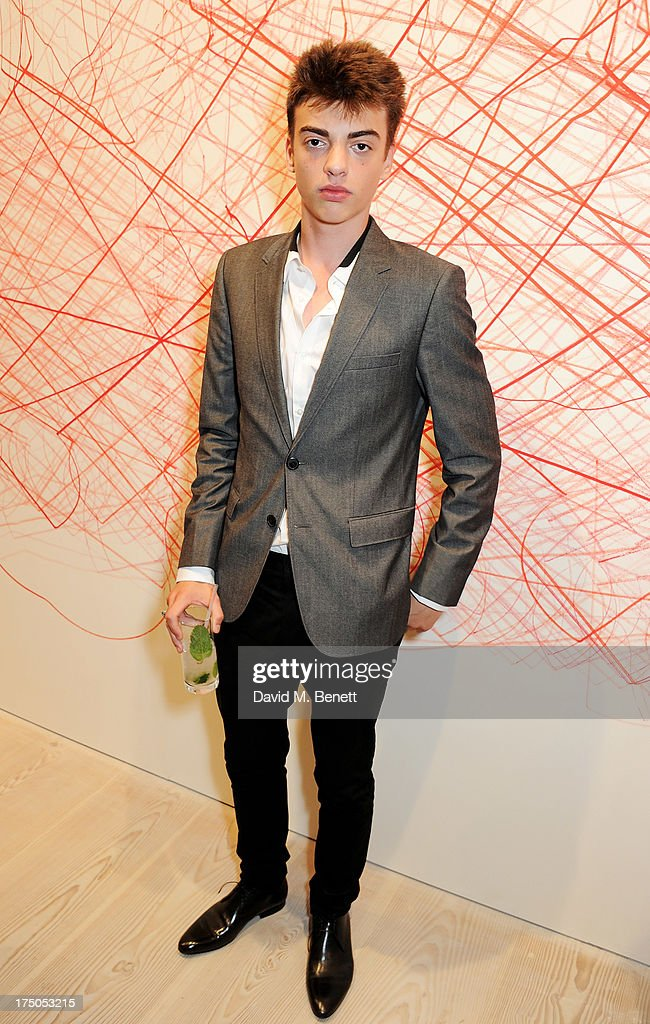Sascha Bailey attends a private view of 'HUGO: Red Never Follows', celebrating 20 years of Hugo Boss, at the Saatchi Gallery on July 30, 2013 in London, England.